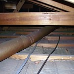 Photo of existing attic batt insulation