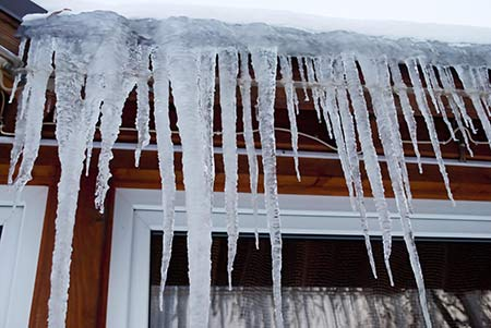 icicles on roof drip line showing poor attic insulation CIMA