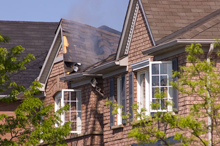 Roof smoldering in house fire CIMA