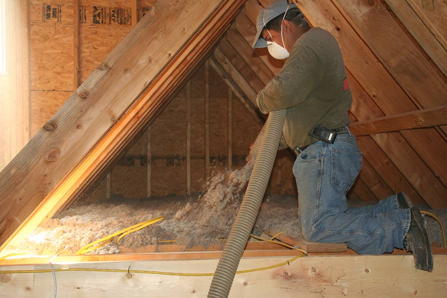 Installing cellulose insulation in attic dry blow in 4090