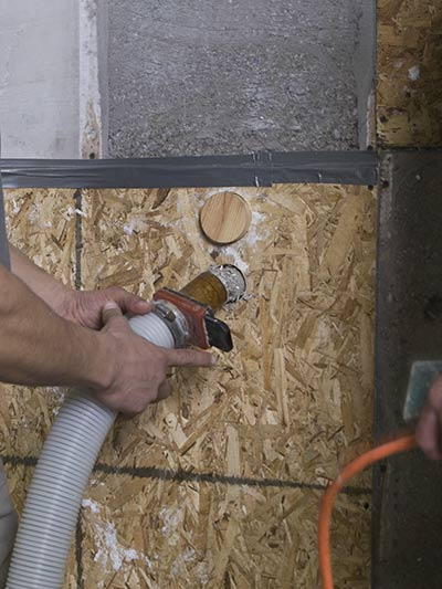 Insulation Contractor dry blow-in installation of cellulose insulation