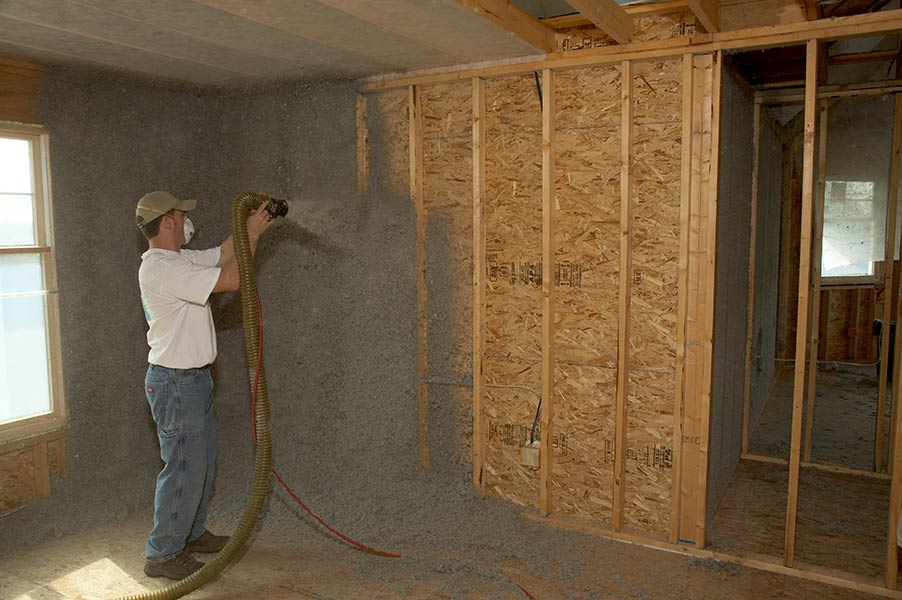 Installing sprayed moisture-added cellulose insulation in wall40240